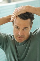 Portrait of a man doing his hair (thumbnail)