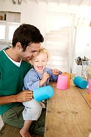 Father and son playing in kitchen