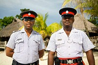 Jamaican policemen 'Red Stripes' Negril beach, Jamaica