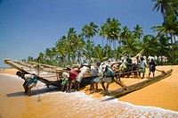 Fishermen and boats on beach, Candolim, Sri Lanka