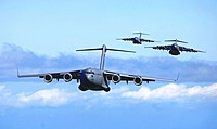 C-17 Globemaster IIIs from the 535th Airlift Squadron, Hickam Air Force Base, Hawaii participate in a 4-ship air drop training mission May 16, 2006. T...