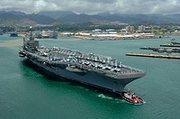 Pearl Harbor, Hawaii (July 5, 2006) - USS Abraham Lincoln (CVN 72) departs from Pearl Harbor, Hawaii to participate in exercise Rim of the Pacific (RI...
