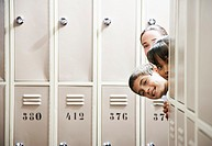 Students peeking around lockers