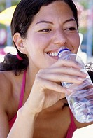 Young woman drinking water from a bottle