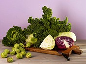 Assorted brassicas on a wooden board