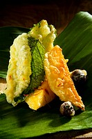 Fruit tempura with mint on banana leaf