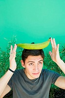 Young man balancing plantain on head