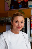 Portrait of a female ice-cream shop owner