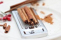Cinnamon sticks on a grater