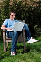 Teenage boy using laptop