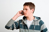 Teenage boy using cell phone