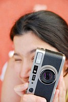 Latino Woman holding a camera