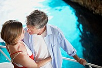 Couple on Tourist Boat Trip in Cave