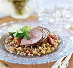 Smoked wild boar ham on chick-pea salad