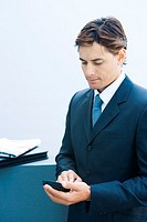 Businessman using electronic organizer
