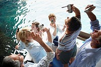 Tourists Using Digital Cameras and Camcorders on Tour Boat Trip