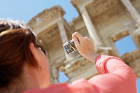 Woman Photographing an Ancient Ruin