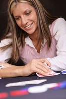 Woman smiling in a card game