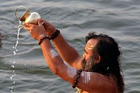 Purification ceremony in tha Ganges River in Benares (Varanasi), Uttar Pradesh. India