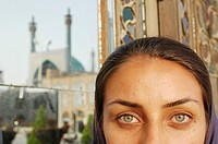 Iranian girl in front of Shah Jame or Masjid-i Shah mosque, also called Imam mosque, Esfahan. Iran