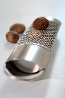 A nutmeg on a grater