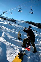 Chair lift, skiers, snowboarder drinking water, Bansko, Bulgaria, Europe,