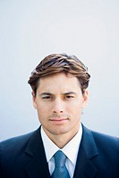 Young businessman looking at camera, portrait, head and shoulders