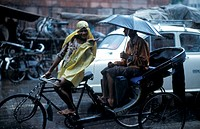 Old DelhiIndia,rainy day, people on bicycle  Muslim India , Asia