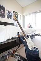 Electric guitar in bedroom, close-up