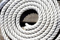 Coiled rope on jetty, close-up (thumbnail)
