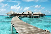 Board walk guiding to bungalows. Maldives Island, Indian Ocean