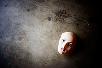 Mannequin face on concrete floor