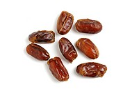 Dried stoned dates on white background