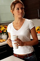Woman In Kitchen With Café Latte