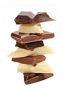 Stack of white, milk and dark, plain chocolate pieces