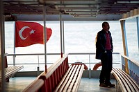 Man alone on a ferry boat waiting for departure. Bosphore, Istanbul, Turkey