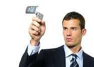 Close-up of a businessman taking a picture of himself with a mobile phone