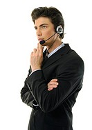 Side profile of a businessman wearing a headset and thinking (thumbnail)