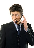 Close-up of a businessman wearing a headset and smiling