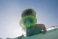 Boy putting face underwater