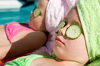 Girls with cucumber slices on eyes (thumbnail)