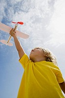 Boy with toy aeroplane