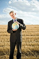 Businessman in a wheat field