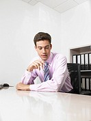 Businessman in an office (thumbnail)