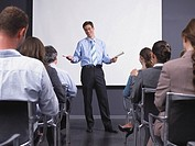 Man giving speech in presentation room