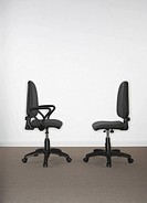 Two office chairs facing each other