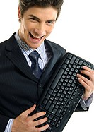 Portrait of a businessman holding a computer keyboard and laughing