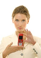 Portrait of a businesswoman showing a mobile phone