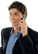 Close-up of a businessman talking on a mobile phone and smiling