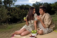 Young couple sharing fresh fruit (thumbnail)